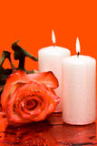 Candle with rose on red Royalty Free Stock Photography