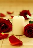 Candle and roses. Stock Image