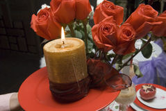 Candle and roses Stock Image