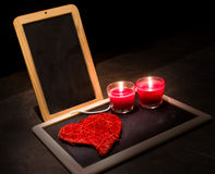 Candle , roses , a blackboard Stock Images