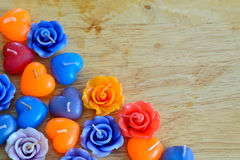 Candle roses and candle hearts on wooden background Stock Photos