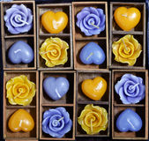 Candle roses and candle hearts in wooden box Stock Image
