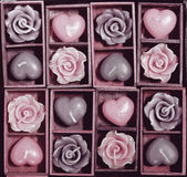 Candle roses and candle hearts in wooden box Stock Photography