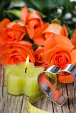 Candle with roses Royalty Free Stock Image