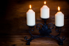 Candle. On rustic wooden background Royalty Free Stock Images