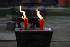 Candle's flame. In the temple, candle's flame burns is very exuberant, hoped that brings safely Royalty Free Stock Images