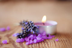 Candle with salt baths and sprigs of lavender Stock Image