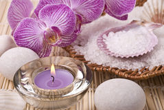 Candle, salt, stones and orchid Stock Image