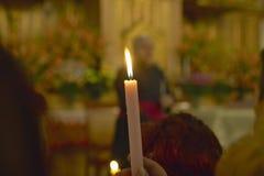 A candle in San Lazaro Catholic Church, El Rincon, Cuba, Stock Photography