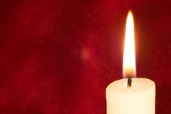 Candle on scarlet Royalty Free Stock Photo