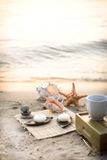 Candle at the sea. Cup of tea and candle at the sea Stock Images