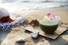 Candle at the sea. One candle at the sea, spa theme Royalty Free Stock Photos