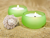 Candle and sea shell on sand Royalty Free Stock Photography