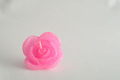 Candle in the shape of a rose. Isolated on a white background Royalty Free Stock Image