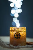 Candle. Shining with christmas lights Royalty Free Stock Photo