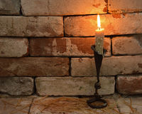 Candle 1. Single burning candle on stone background in night Stock Images