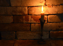 Candle 3. Single burning candle on stone background in night Royalty Free Stock Images