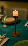 Candle. Single candle on a table Stock Photo