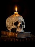 Candle on skull 2 Royalty Free Stock Images