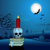 Candle on Skull in Halloween Night Stock Photos