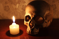 The candle and the skull Stock Photos