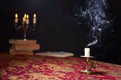 Candle in small brass candlestick royalty free stock image