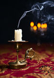 Candle in small brass candlestick royalty free stock photography