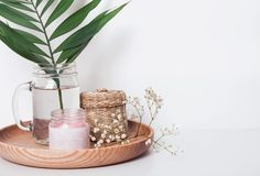 Candle, small strw backet and other cozy home items Stock Image