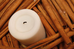 Candle. Small white pillar candle with cinnamon sticks Stock Image