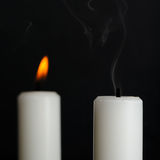 Candle with Smoke and Burning Candle on Black Royalty Free Stock Images