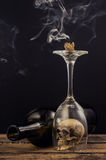 Candle and smoke over wine glass Royalty Free Stock Photos