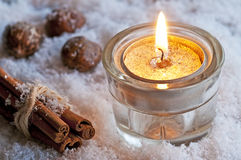 Candle in snow Stock Image