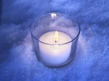 Candle in the snow Stock Photos