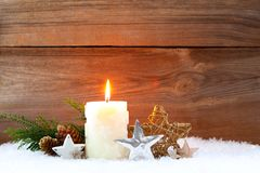 Candle in snow christmas background stock photography
