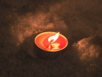 Candle in the snow Royalty Free Stock Photo