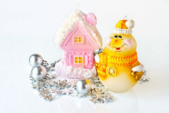 Christmas candles and toys. On a light background Stock Images