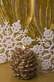 Candle, snowflakes ans champagne Stock Images