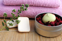 Candle and soap on bamboo background. Concept of wellness Royalty Free Stock Photos
