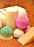 Candle, soap, bath bombs and bath towel Royalty Free Stock Photo