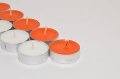 Candle. A candle is a solid block of wax with an embedded wick which is ignited to provide light and in some cases a fragrance. It can also be used to provide Stock Image