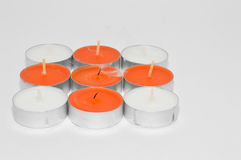 Candle. A candle is a solid block of wax with an embedded wick which is ignited to provide light and in some cases a fragrance. It can also be used to provide Stock Photo
