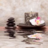 Candle and spa stones Royalty Free Stock Images