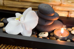 Candle and spa stones for decoration in a spa center Stock Image
