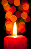 Candle and specks of light. On a black background Stock Image