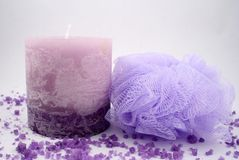 Candle and Sponge. A purple candle, some bath crystals and a sponge Royalty Free Stock Photos
