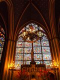 Candle and stained window in Notre Dame , Paris Stock Photo