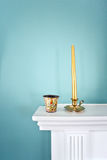 Candle stand. Gold candle stand on white table Stock Image