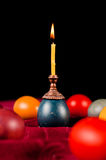 Candle standing on easter egg Royalty Free Stock Photography