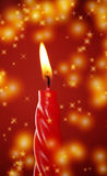 Candle and stars. A red candle with stars and romantic lightning in soft blur motion royalty free stock photo