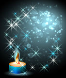 Candle and stars. Burning candle, boke and stars Stock Photography